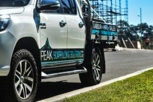 Peak scaffolding solutions design logo on vehicle
